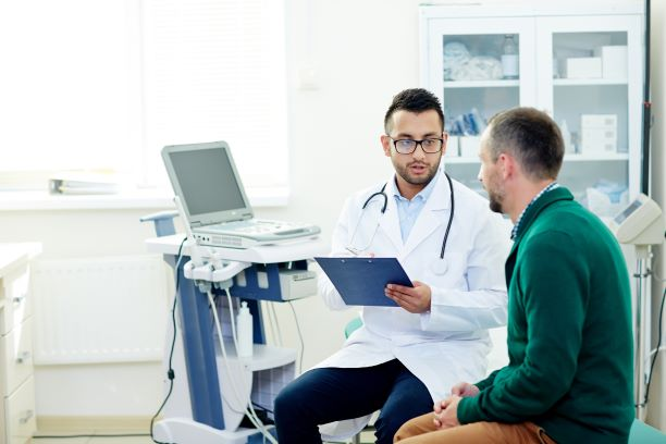 doctor discussing a procedure with male patient